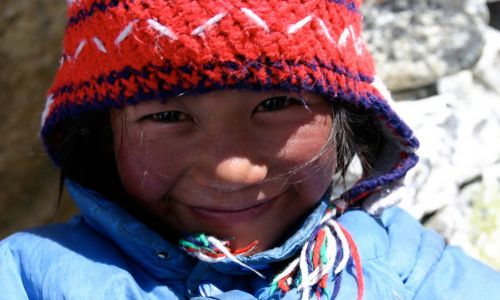 Smiling girl, Nepal. Alpin Technik Leipzig pays the whole rent of the Dolpo Hostel in Khatmandu for 1 year. Founded in 2008, the Hostel enables children from poor regions to visit school in Khatmandu.